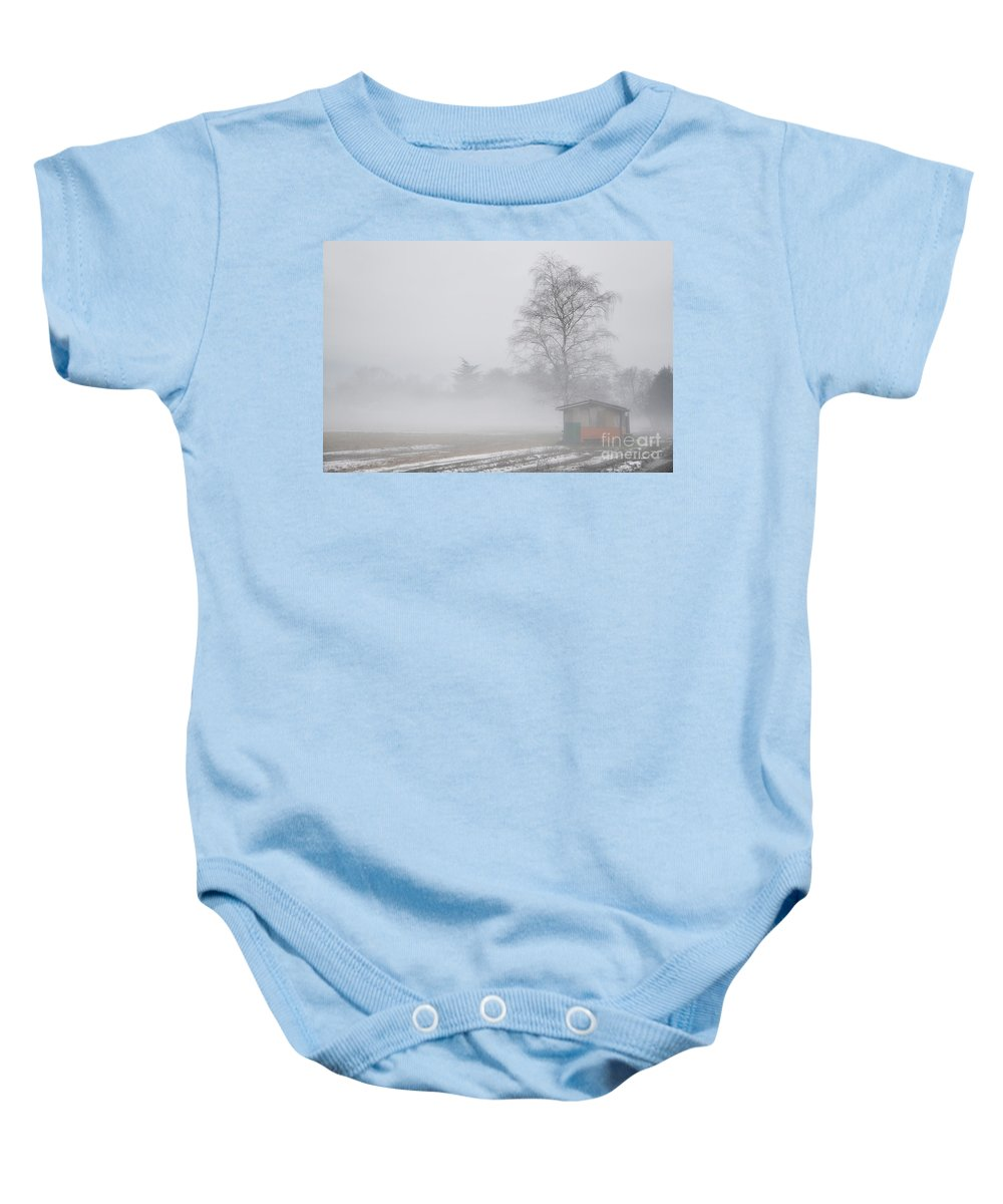 Trees Baby Onesie featuring the photograph Tree And A House On The Fog by Mats Silvan