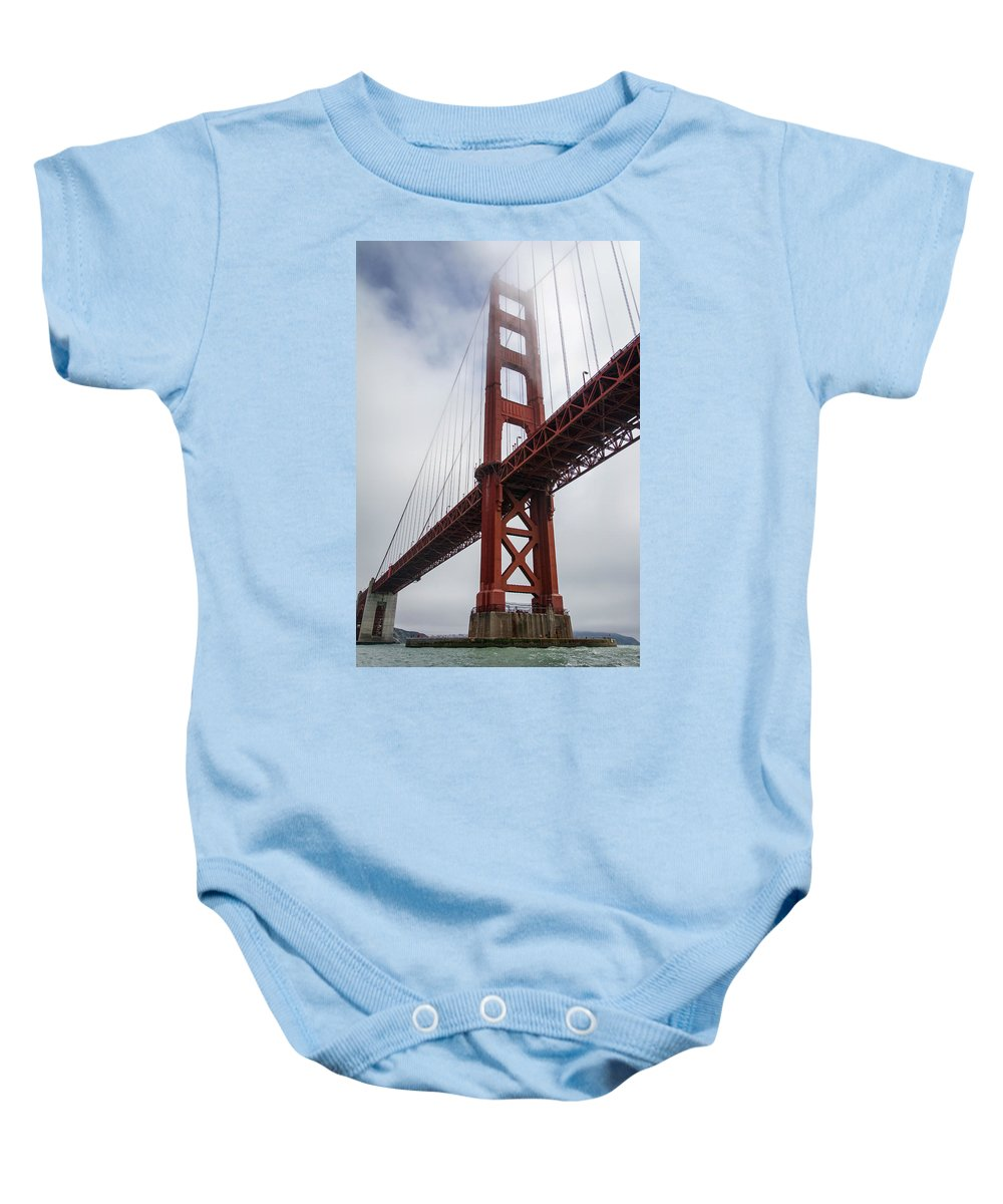 Golden Gate Bridge Baby Onesie featuring the photograph Under The South Tower by Hugh Stickney