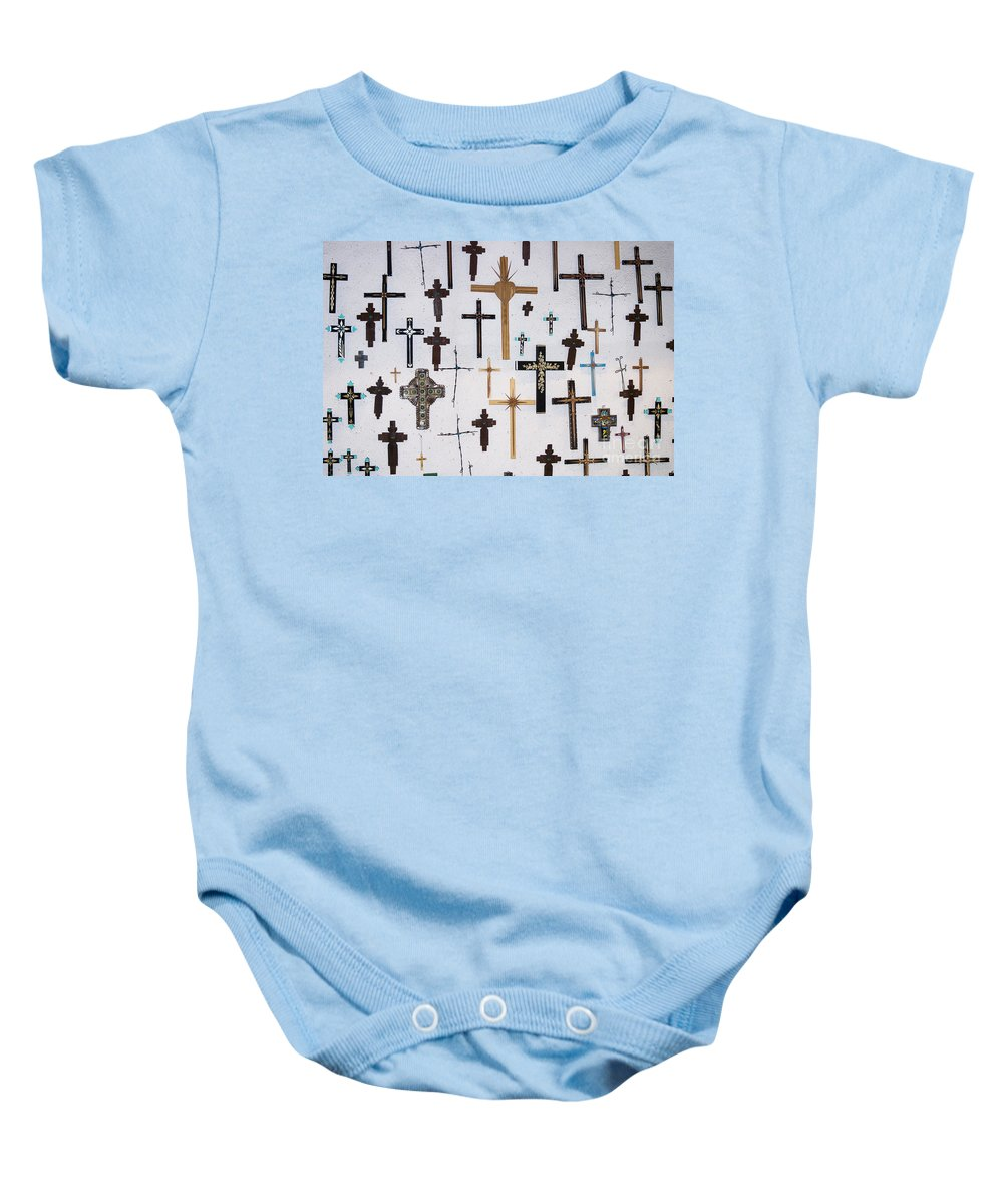 Crucifxes Baby Onesie featuring the photograph Wall Of Crosses by John Greco