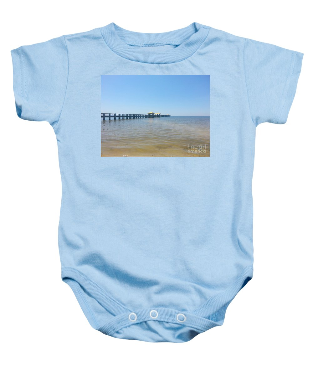 West Side Pier Baby Onesie featuring the photograph West Side Pier by Alys Caviness-Gober