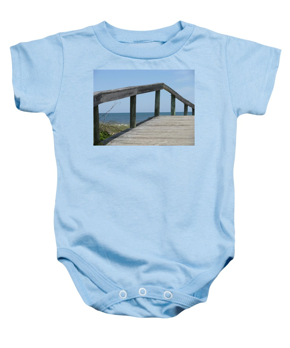 Landscape Baby Onesie featuring the photograph What Goes Up by Ellen Meakin