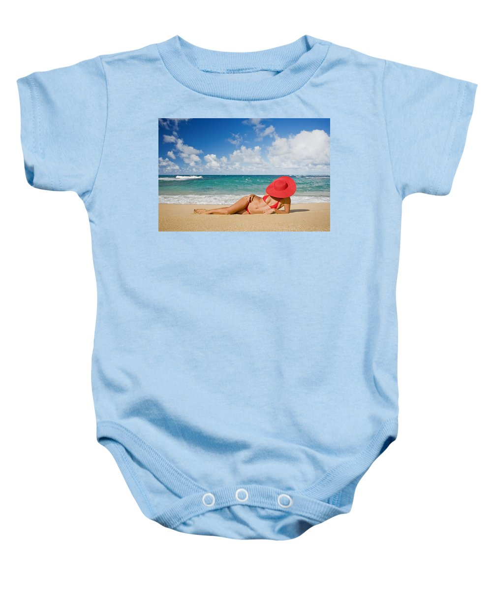 Afternoon Baby Onesie featuring the photograph Woman Sitting On The Beach by M Swiet Productions