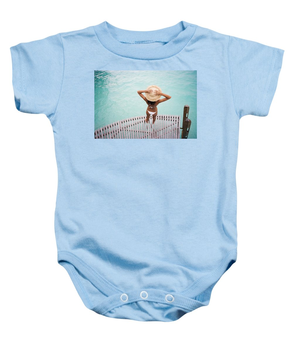 Afternoon Baby Onesie featuring the photograph Woman Standing On Dock by M Swiet Productions