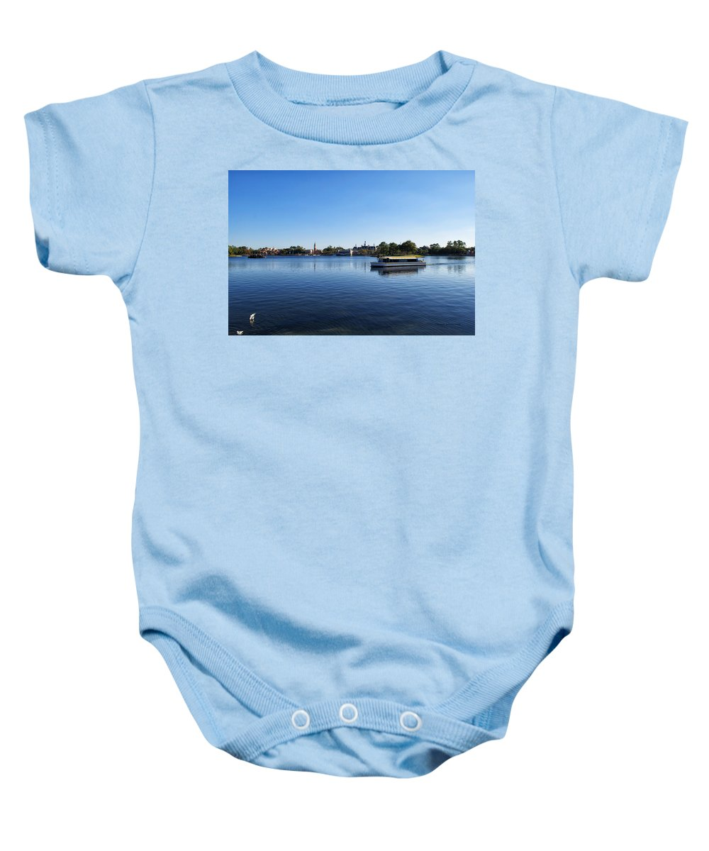 Epcot Baby Onesie featuring the photograph World Showcase Lagoon Walt Disney World by Thomas Woolworth