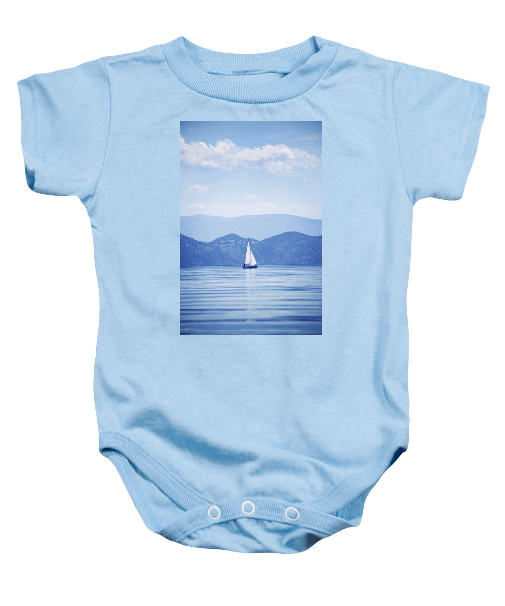 Transportation Baby Onesie featuring the photograph A Sailboat by Kelly Redinger