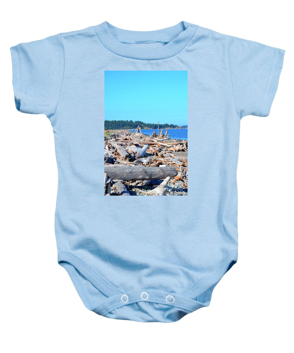British Columbia Baby Onesie featuring the photograph Beach Of Logs by Traci Cottingham