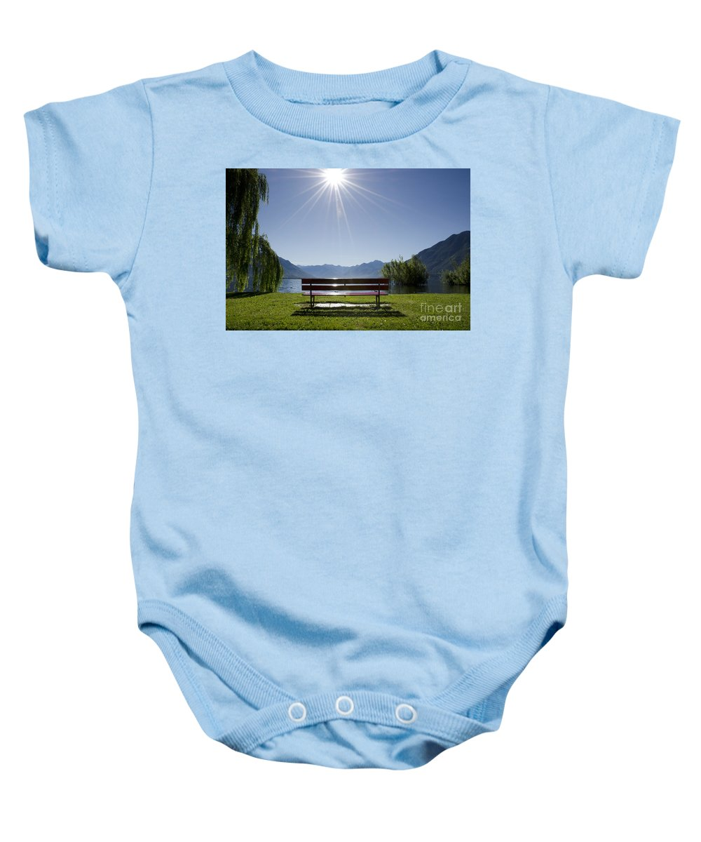Bench Baby Onesie featuring the photograph Bench On The Lakefront by Mats Silvan