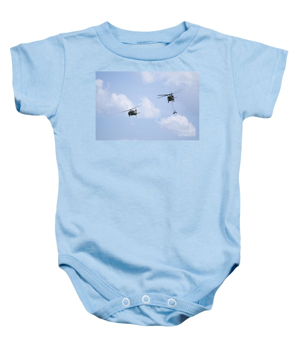 Us Army Baby Onesie featuring the photograph Blackhawk Sling Load by Tim Mulina