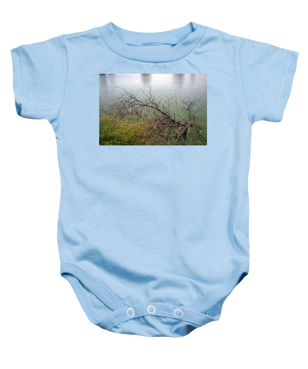Original Baby Onesie featuring the photograph Branchs Over The Waters Edge 2001 by Carl Deaville