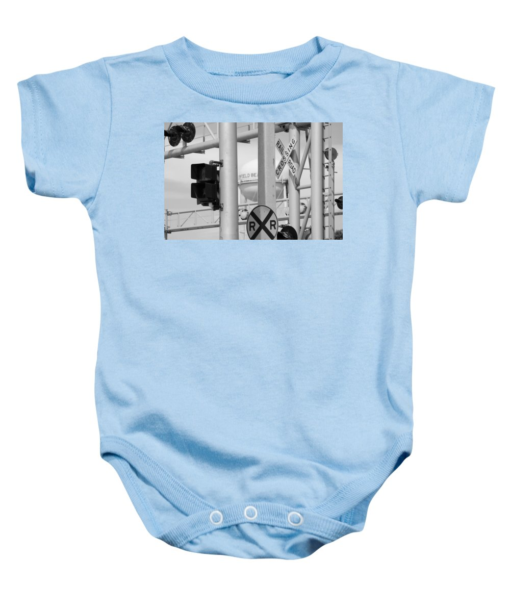 Black And White Baby Onesie featuring the photograph Crossing Signs In Black And White by Rob Hans