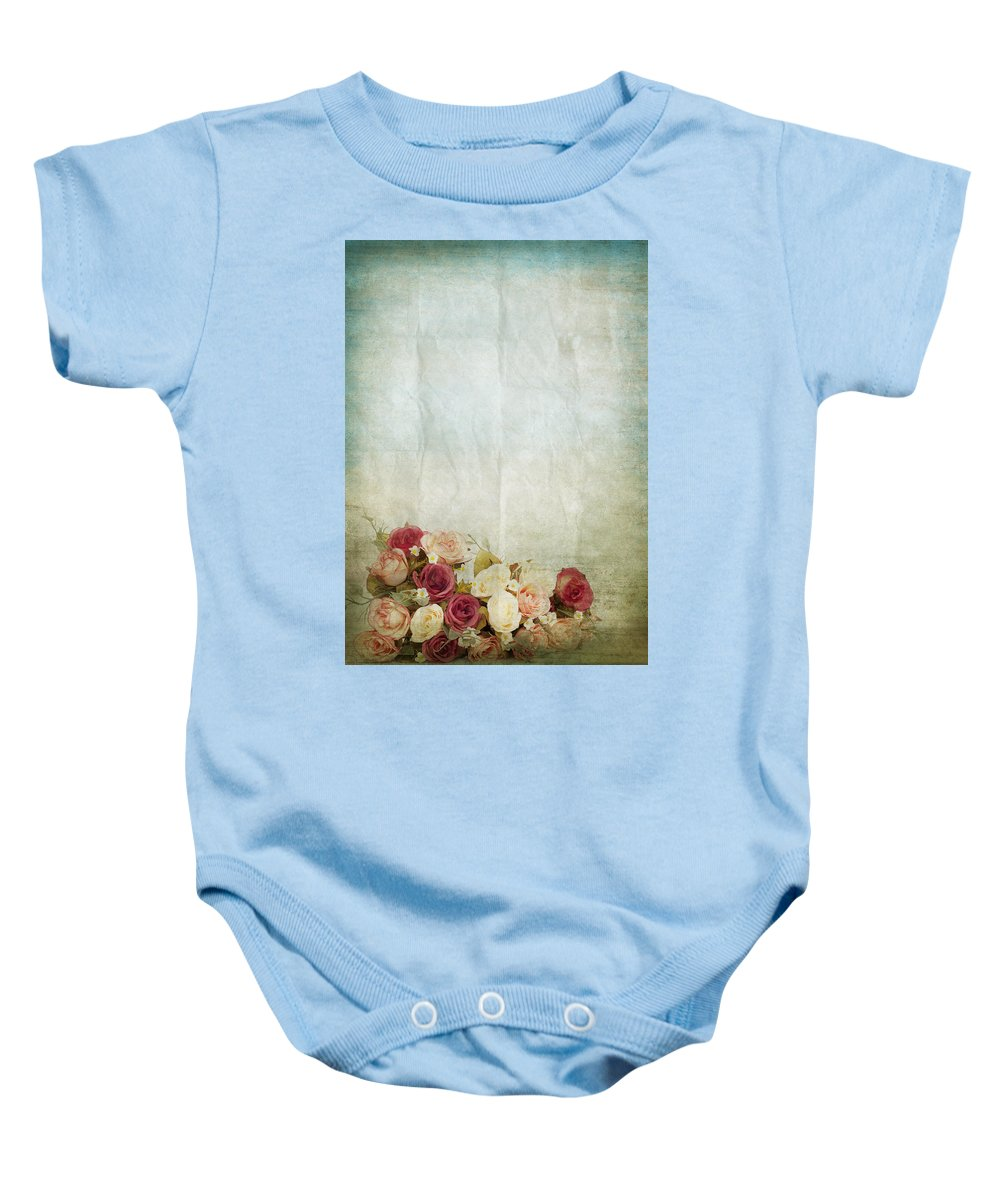 Abstract Baby Onesie featuring the photograph Floral Pattern On Old Paper by Setsiri Silapasuwanchai