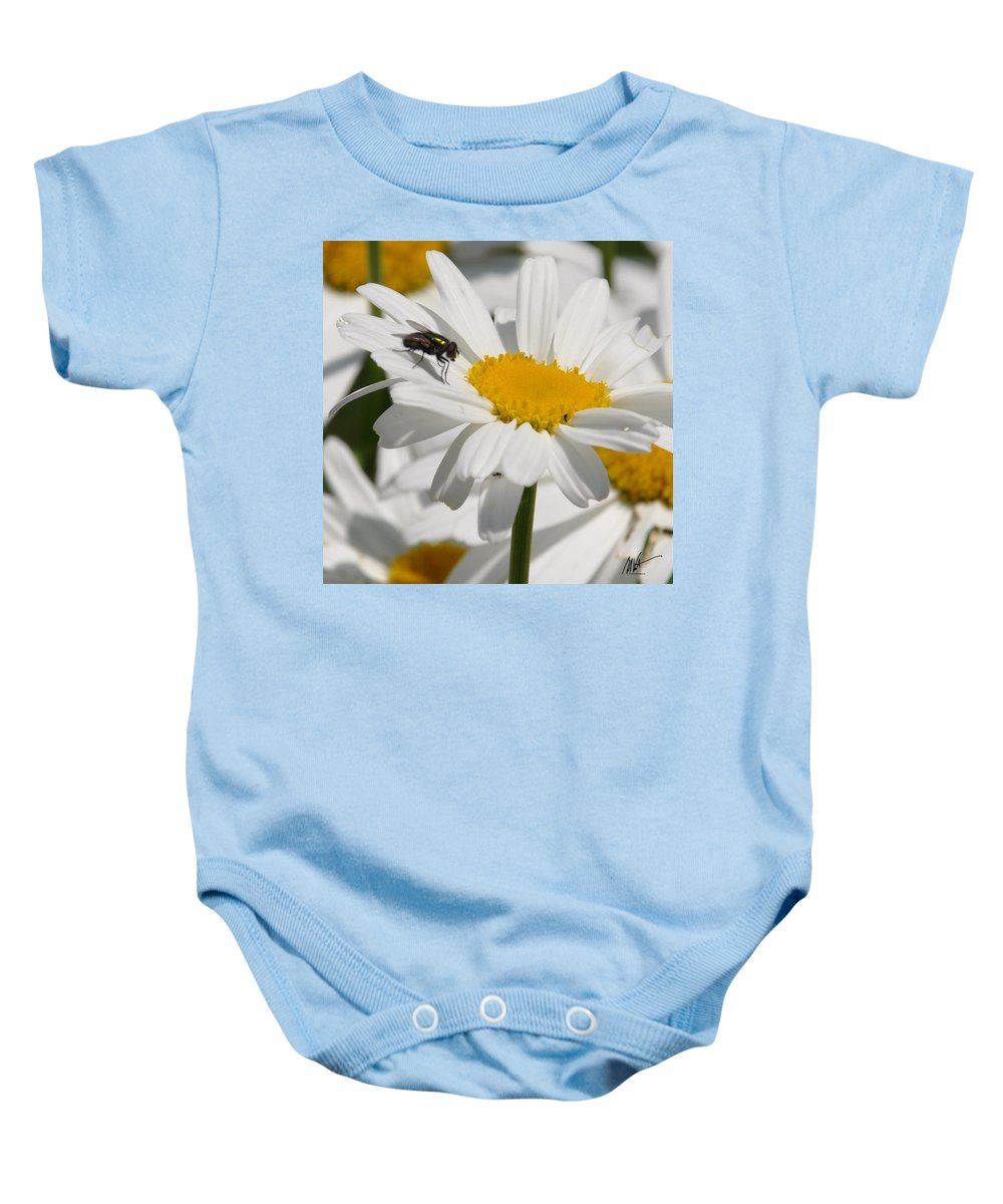 Baby Onesie featuring the photograph Fly In The Flower by Mark Valentine