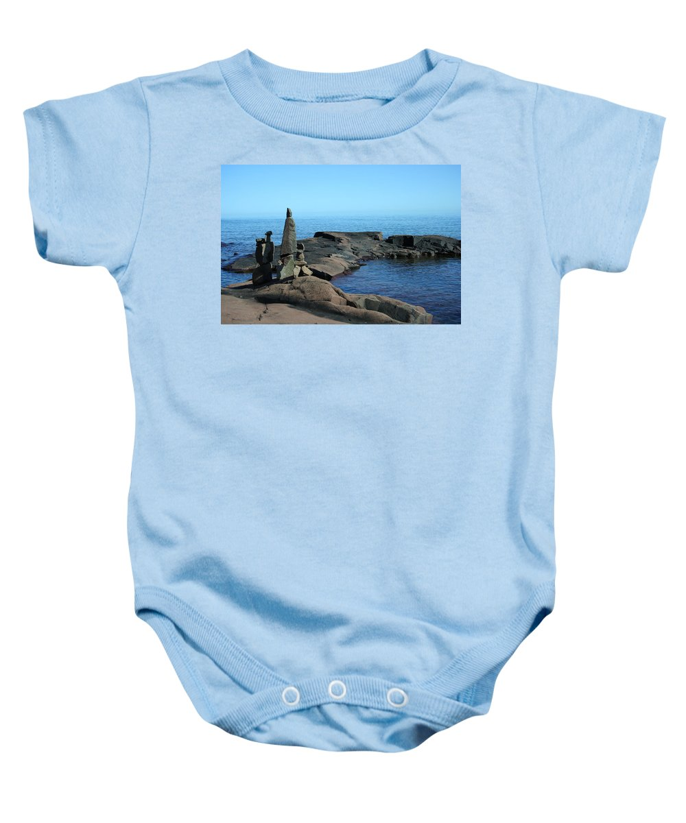 Baby Onesie featuring the photograph Grand Marais Harbor Rock Family by Joi Electa