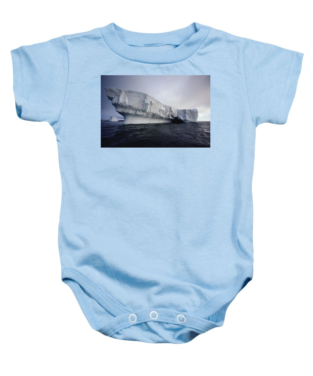 00089902 Baby Onesie featuring the photograph Iceberg Palmer Peninsula Antarctica by Flip Nicklin