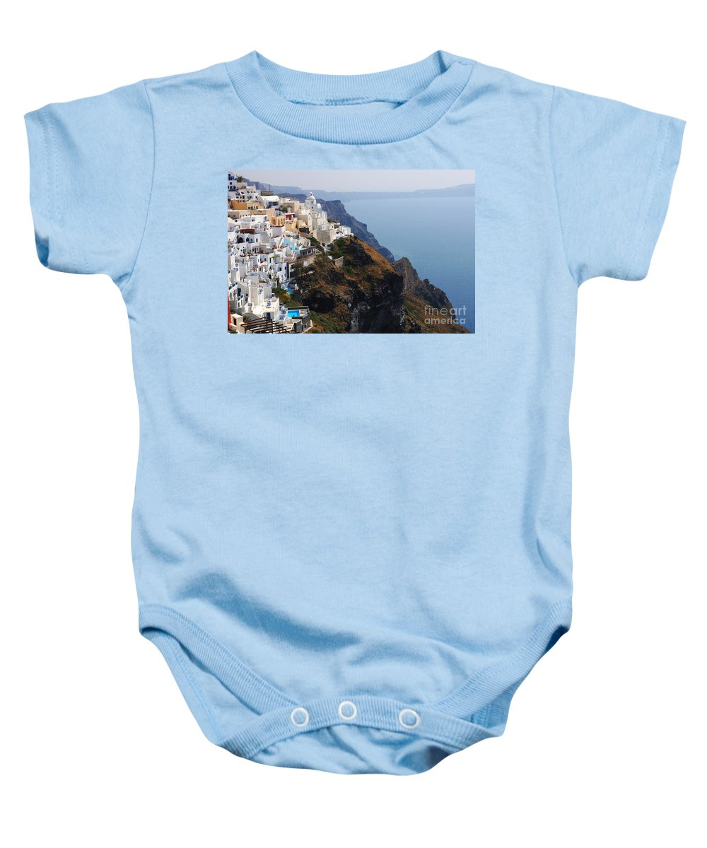 The Edge Baby Onesie featuring the photograph Living On The Edge In Santorini by Bob Christopher