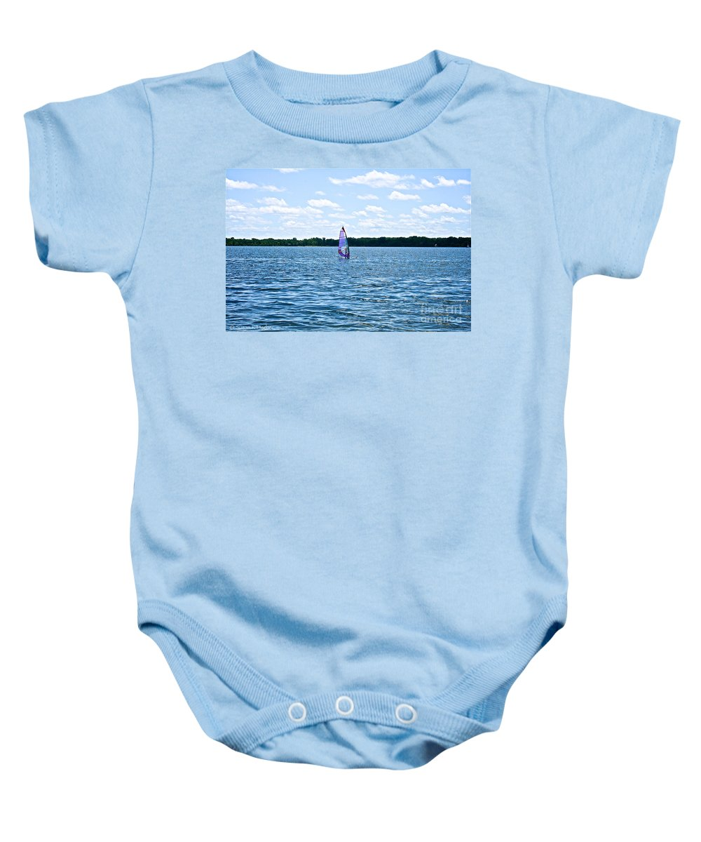 Minnesota Baby Onesie featuring the photograph Lone Wind Surfer by Susan Herber