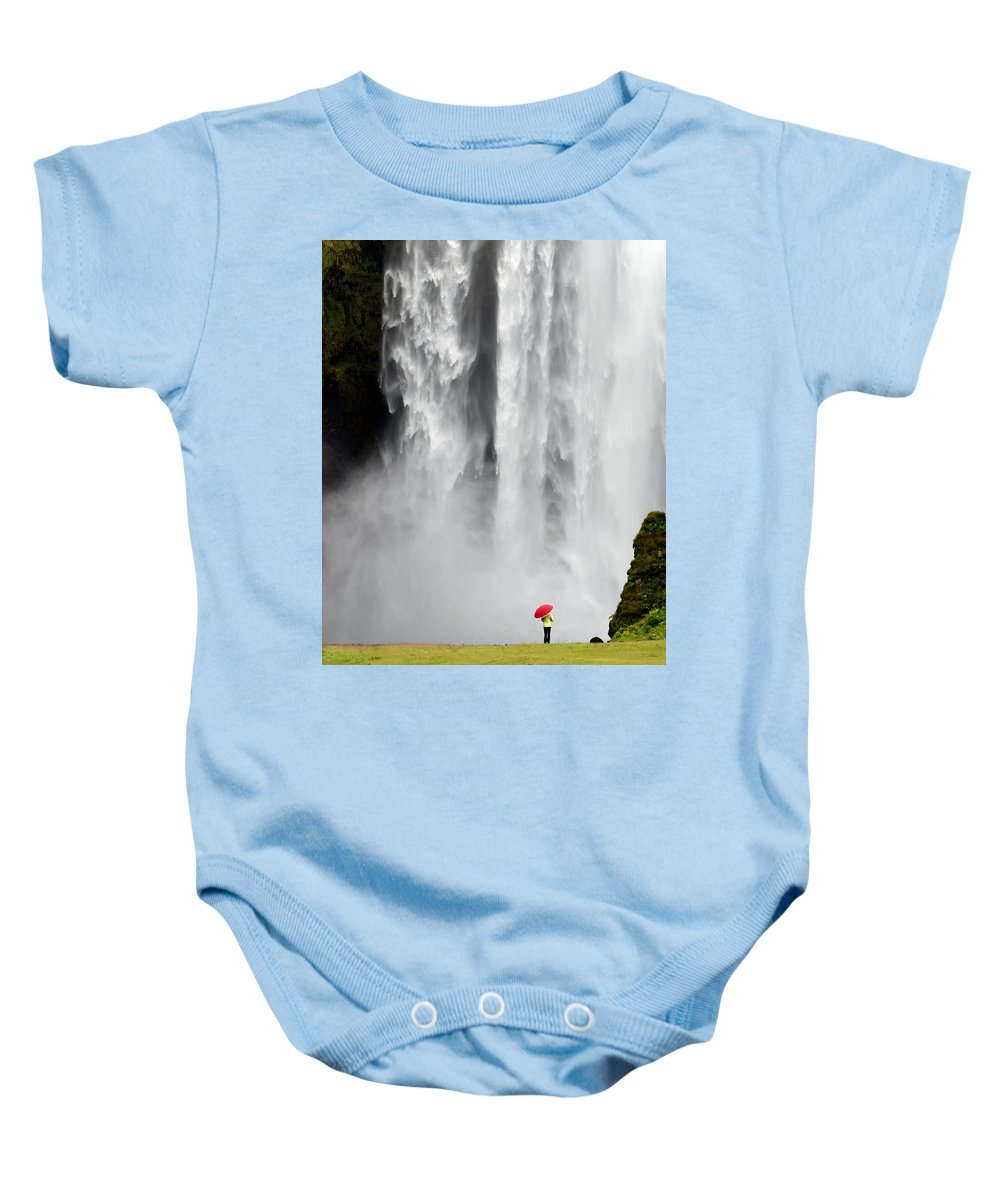 Landscape Baby Onesie featuring the photograph Red Umbrella At Skogafoss by Kenneth Blye