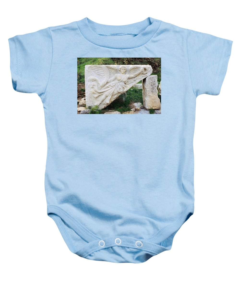 Stone Carving Baby Onesie featuring the photograph Stone Carving Of Nike by Mark Greenberg
