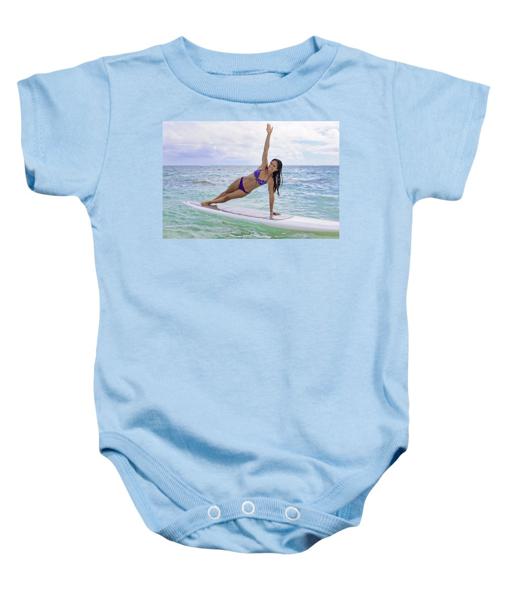 Active Baby Onesie featuring the photograph Surfboard Yoga by Tomas del Amo - Printscapes