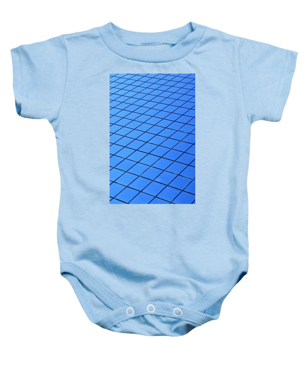 Pattern Baby Onesie featuring the photograph Symmetrical Pattern Of Blue Squares by David Chapman