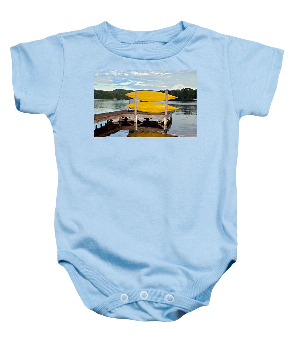 Baby Onesie featuring the photograph Yellow Kayaks by Susan Leggett