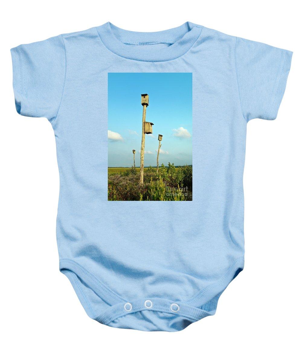 Cape Cod Baby Onesie featuring the photograph Birdhouses In Salt Marsh. by John Greim