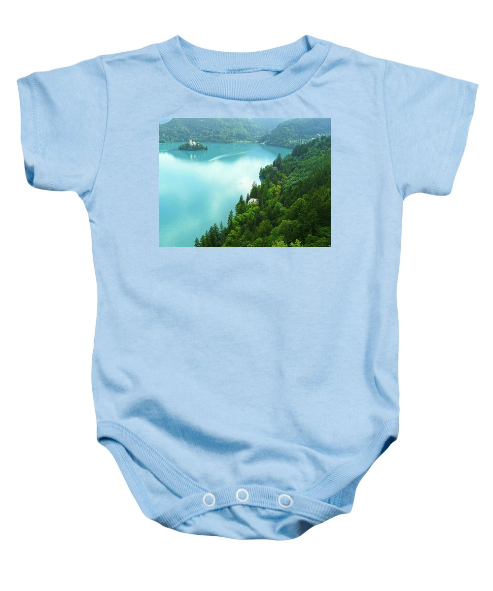 Island Baby Onesie featuring the photograph Bled by Daniel Csoka