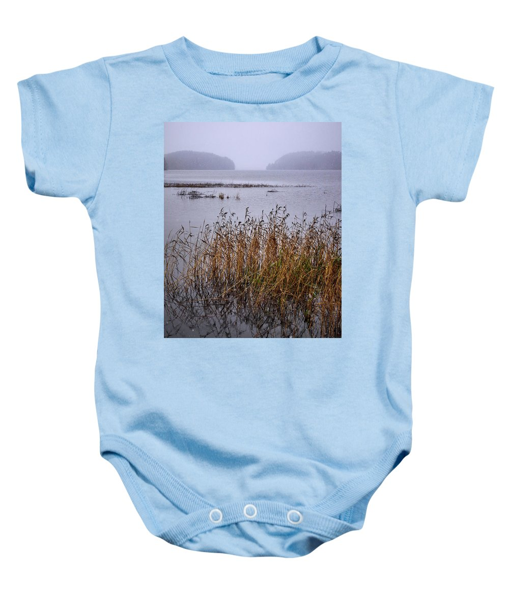 Finland Baby Onesie featuring the photograph First Snow Falling by Jouko Lehto