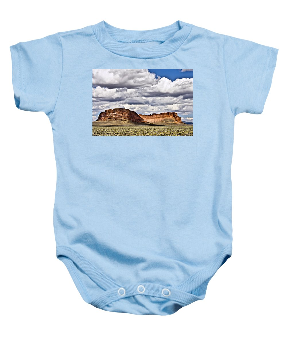 Fort Rock Baby Onesie featuring the photograph Fort Rock by Albert Seger