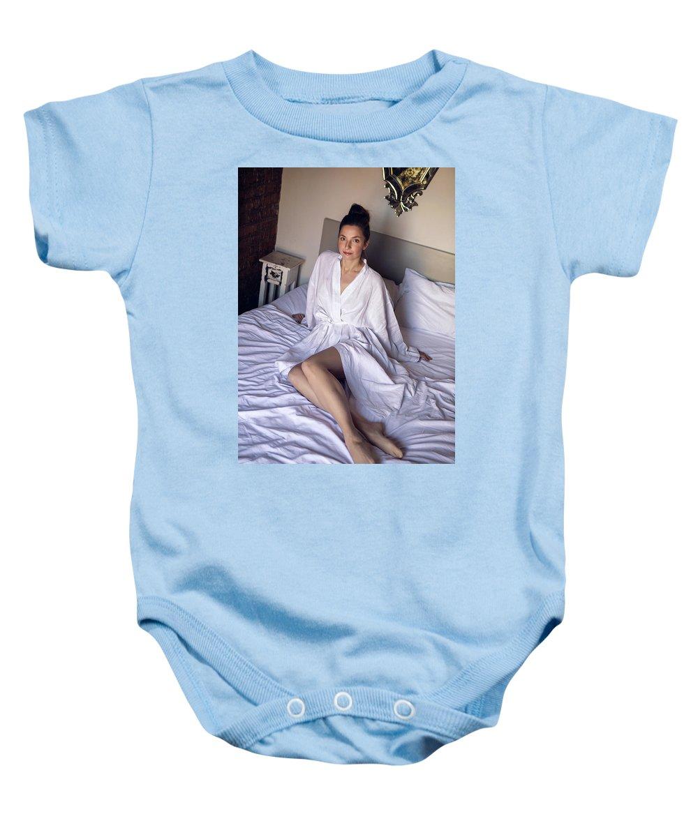 Bathrobe Baby Onesie featuring the photograph girl in the Bathrobe lying by Elena Saulich