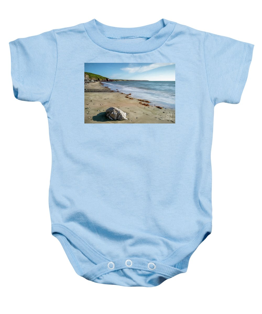 Rock Baby Onesie featuring the photograph Seascape Wales by Adrian Evans