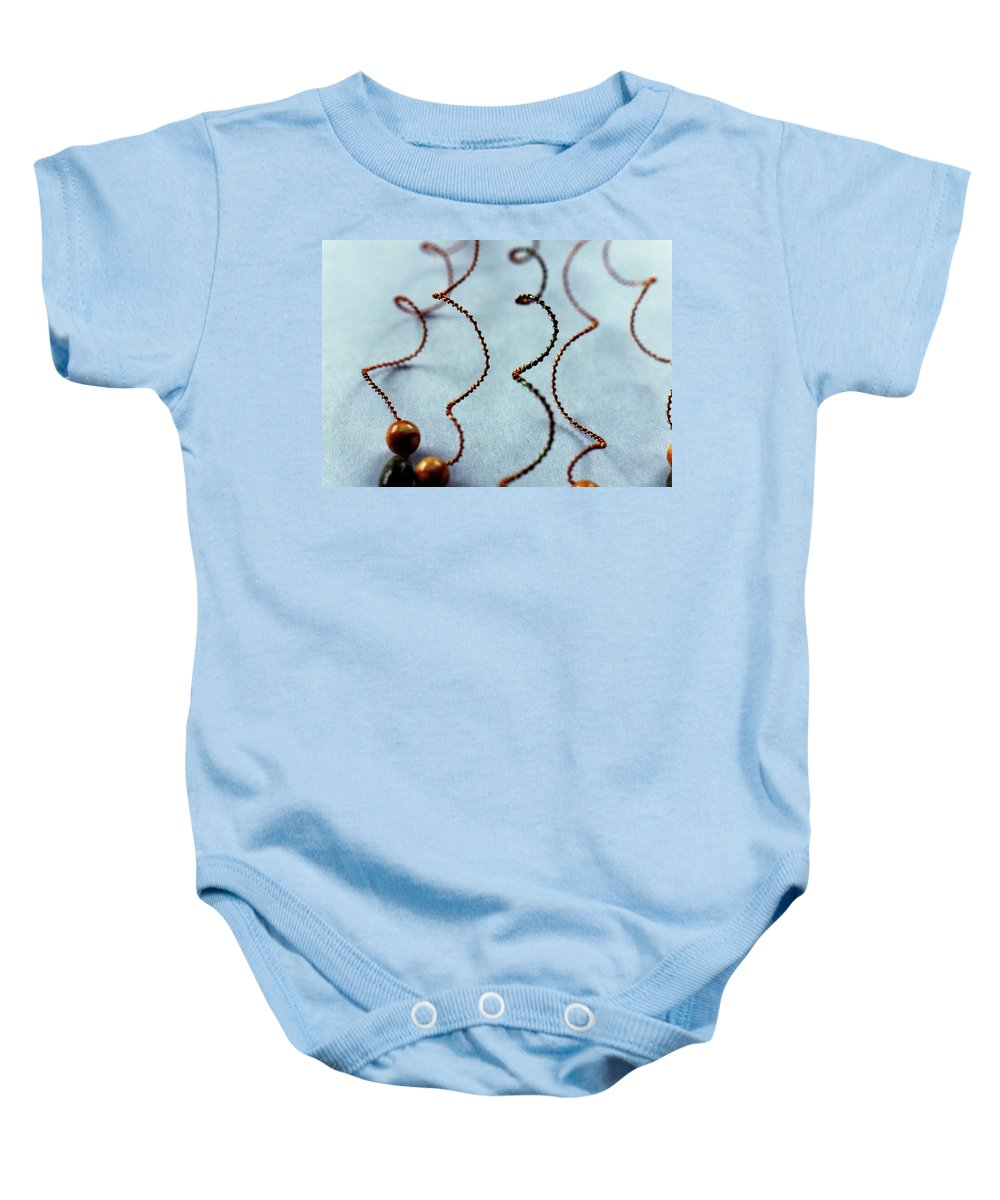 Wire And Beads Baby Onesie featuring the photograph Wirework by Catt Kyriacou