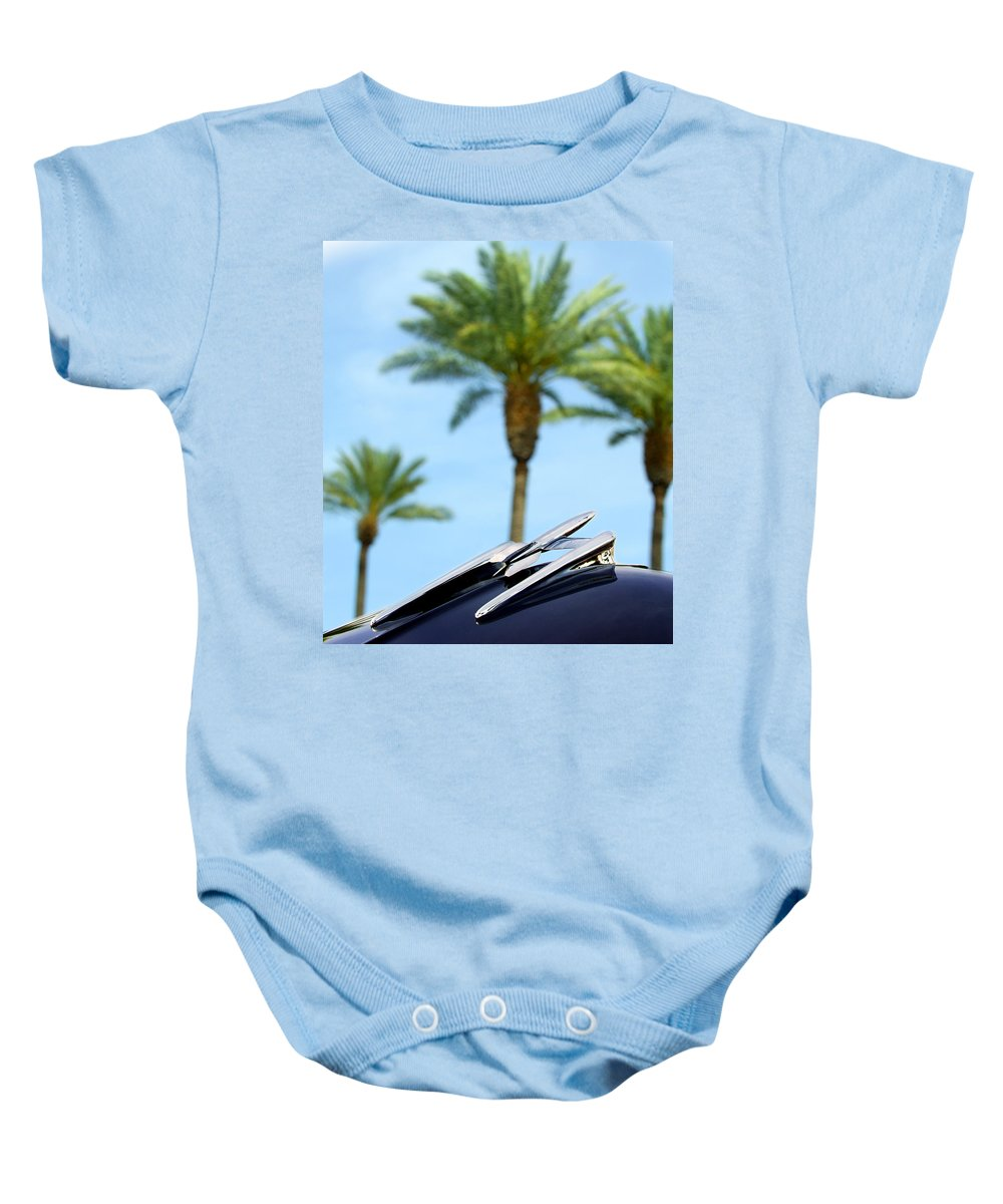 Car Baby Onesie featuring the photograph 1950 Oldsmobile Rocket 88 Convertible Hood Ornament And Palms by Jill Reger