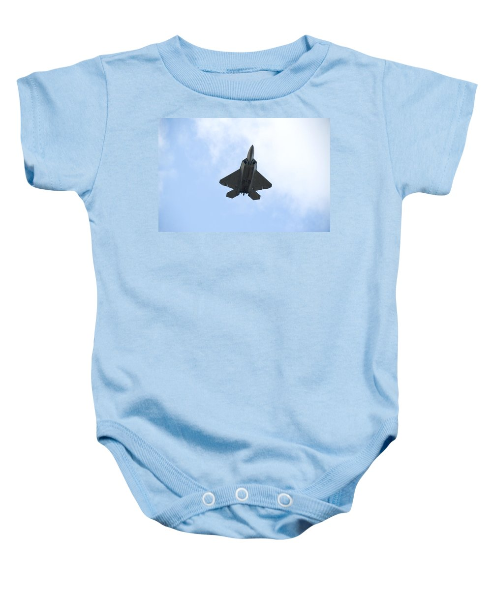 Airplane Baby Onesie featuring the photograph F-22 Raptor by Sebastian Musial