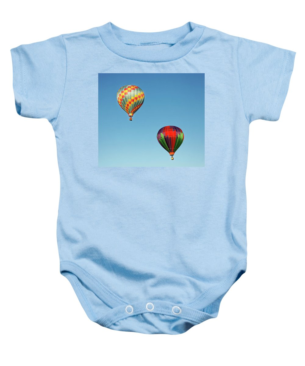Balloons Baby Onesie featuring the photograph Hot Air Balloons by Robert Urwyler