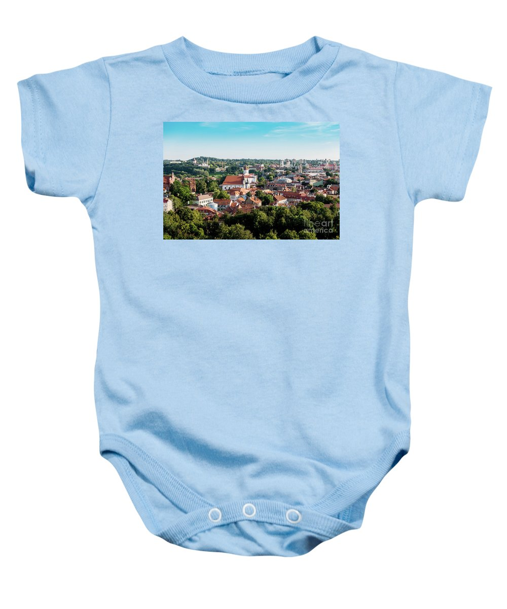 Vilnius Baby Onesie featuring the photograph view of downtown in Vilnius city, Lithuanian by Otto