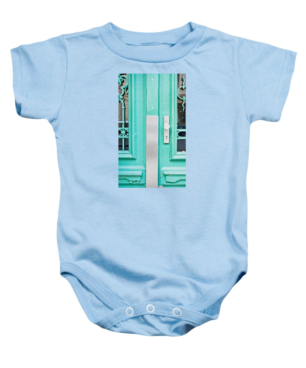Access Baby Onesie featuring the photograph Blue Door by Tom Gowanlock