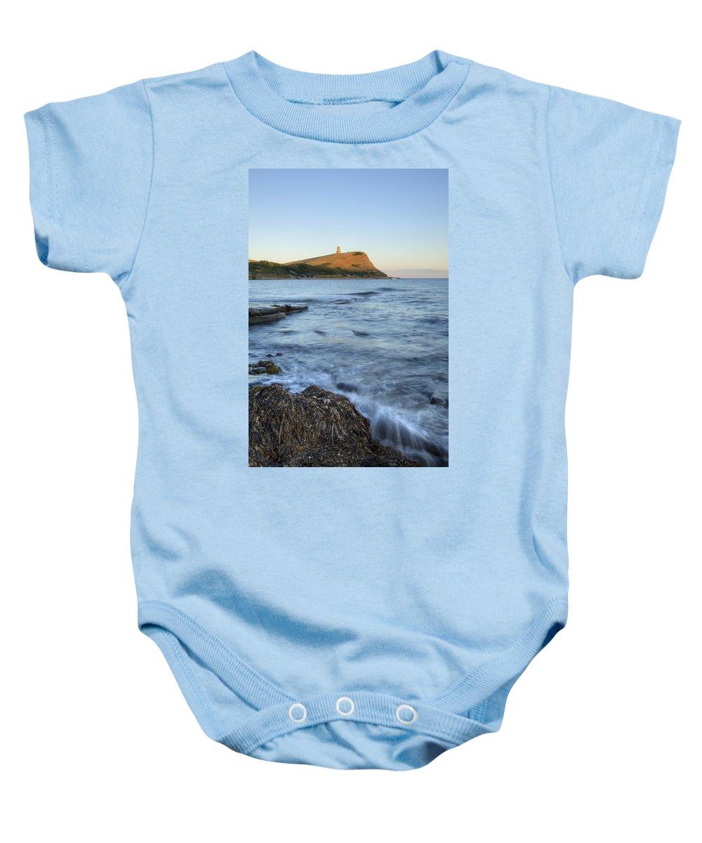 Kimmeridge Baby Onesie featuring the photograph Kimmeridge Bay In Dorset by Ian Middleton