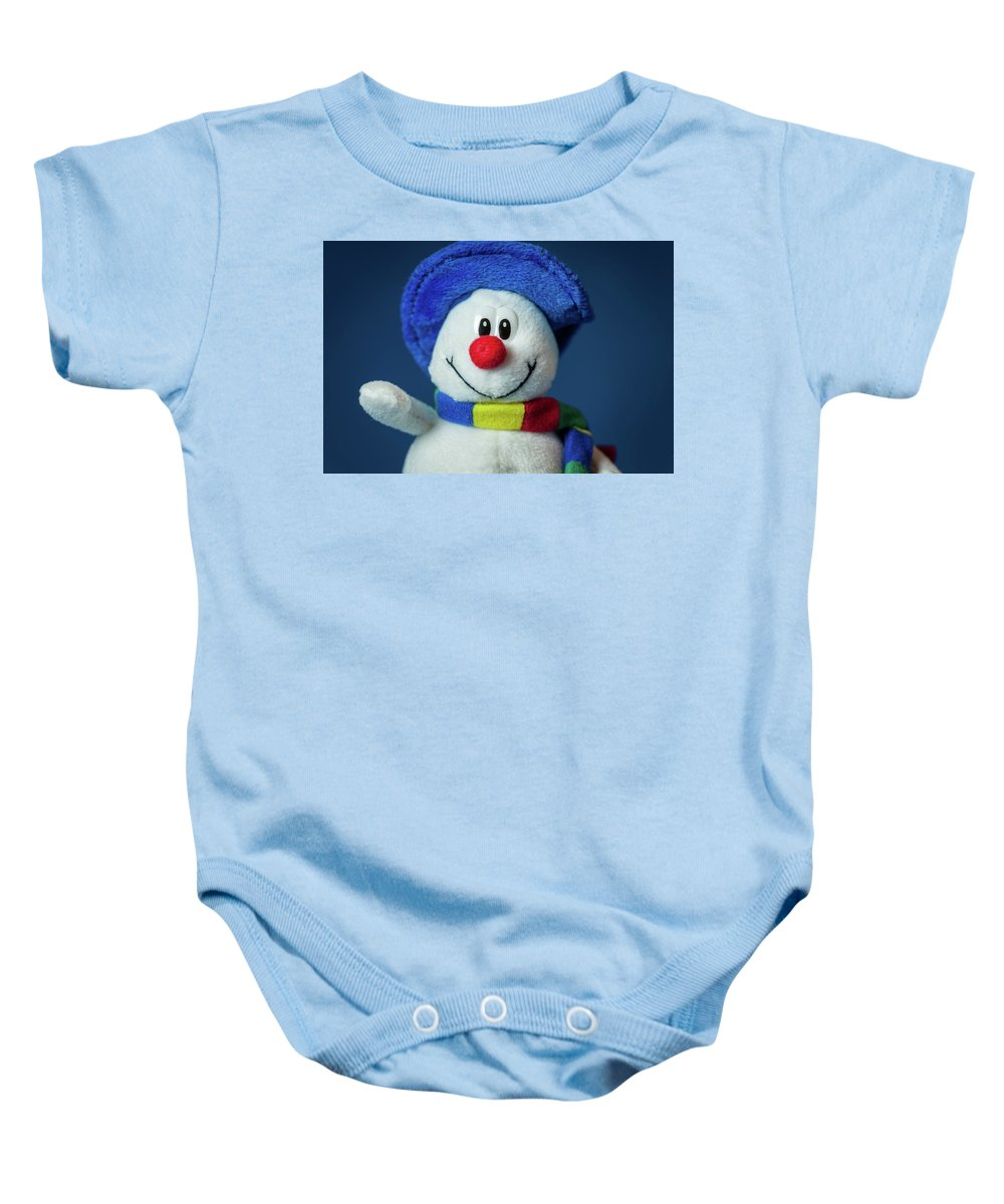 White Baby Onesie featuring the photograph A Cute Little Soft Snowman With A Blue Hat And A Colorful Scarf by Stefan Rotter