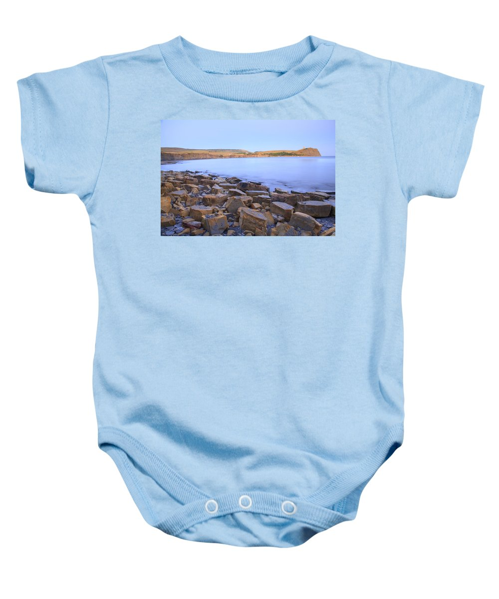 Kimmeridge Baby Onesie featuring the photograph Kimmeridge Bay In Dorset by Ian Middleton