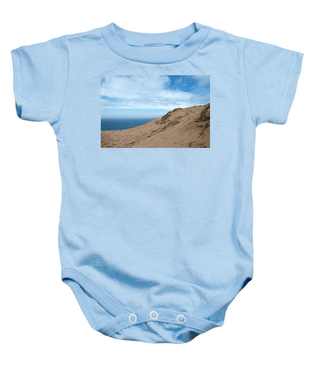 Sleeping Bear Dunes Baby Onesie featuring the photograph A Lot Of Sand by Linda Kerkau