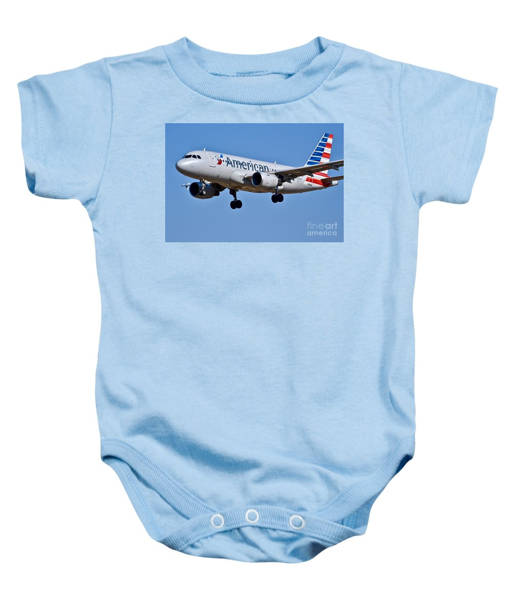 Aa Plane Baby Onesie featuring the photograph American Airlines Plane Preparing To Land At The Bwi Airport by Jeramey Lende