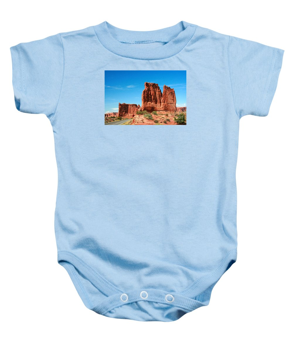 Arches National Park Baby Onesie featuring the painting Arches National Park From A Utah Highway by Corey Ford