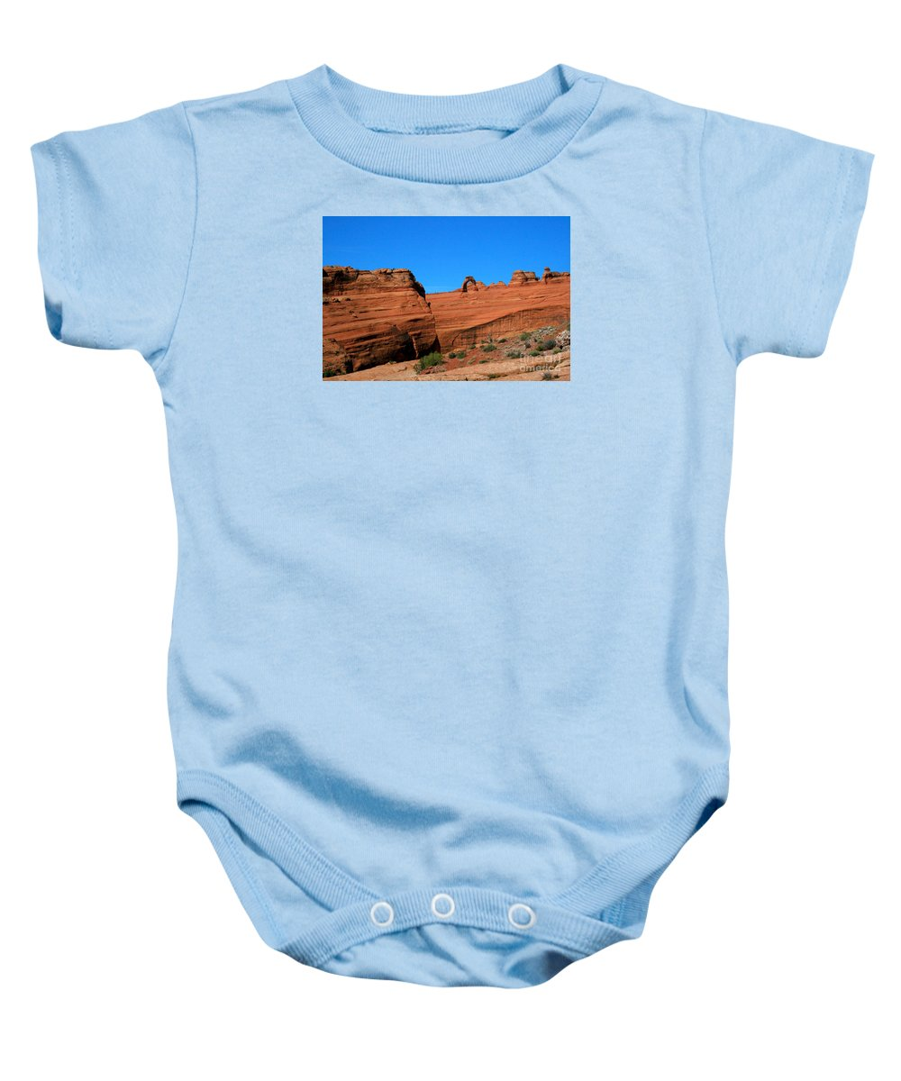 Arches National Park Baby Onesie featuring the painting Arches National Park, Utah Usa - Delicate Arch by Corey Ford