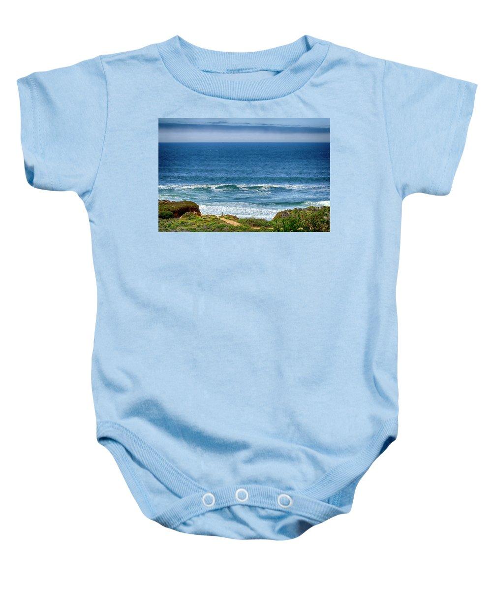 Seascape Baby Onesie featuring the photograph Beach Cloud Streak by Joseph Hollingsworth