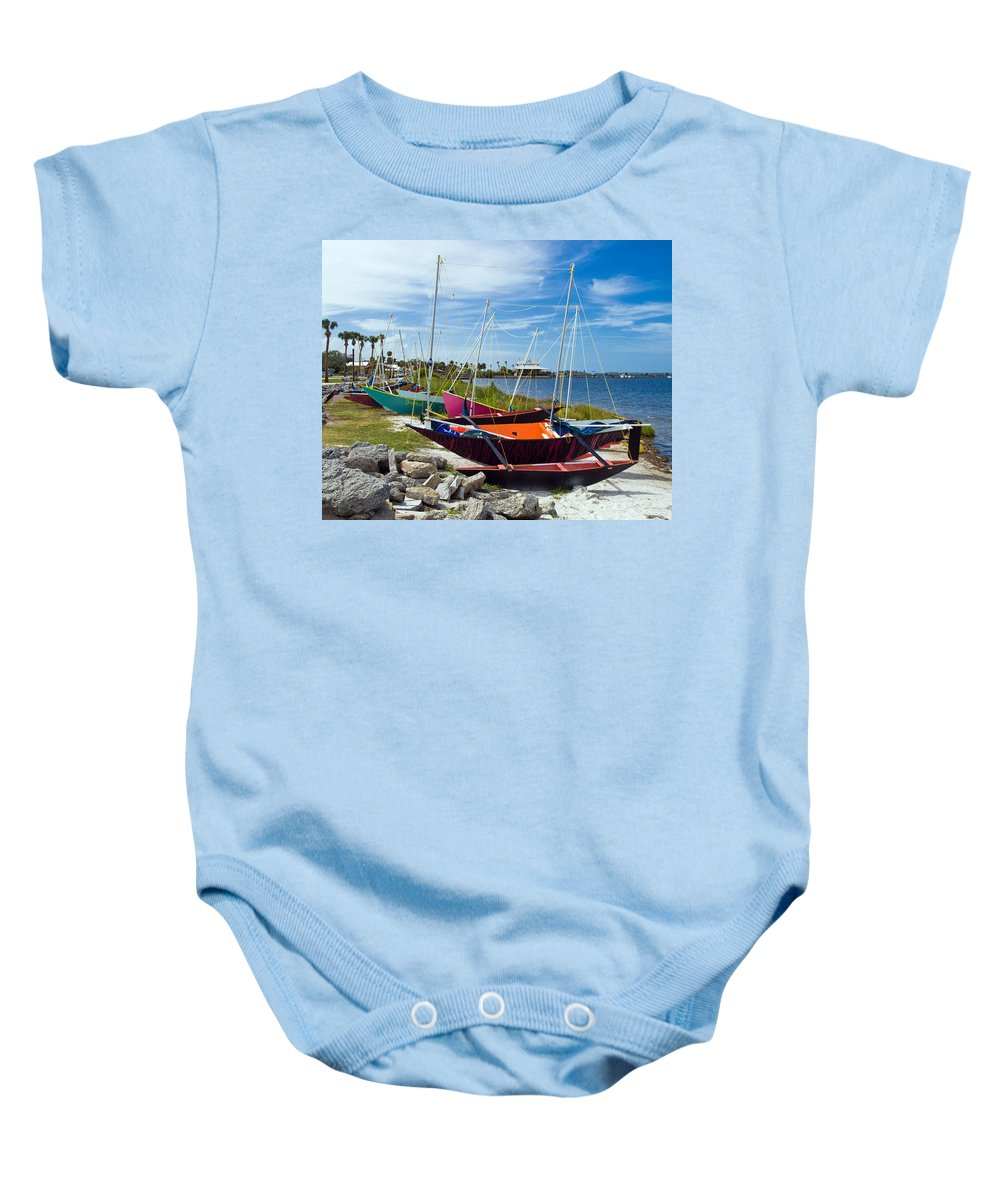 Sail; Sailing; Boat; Sailboat; Mast; Plywood; Homemade; Boy; Scouts; Fleet; Class; Dragon; Tiller; F Baby Onesie featuring the photograph Beached In Sebastian Florida by Allan Hughes
