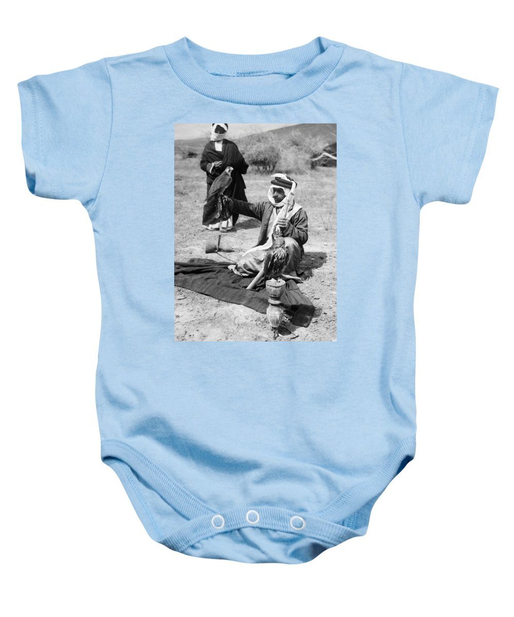 1910 Baby Onesie featuring the photograph Bedouin Falconer, C1910 by Granger