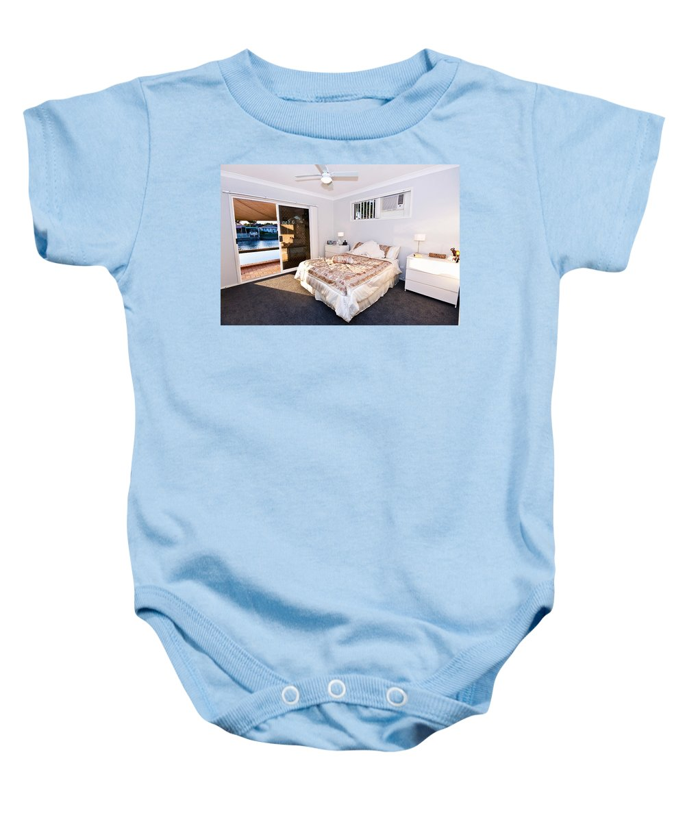 Bed Baby Onesie featuring the photograph Bedroom With River View by Darren Burton