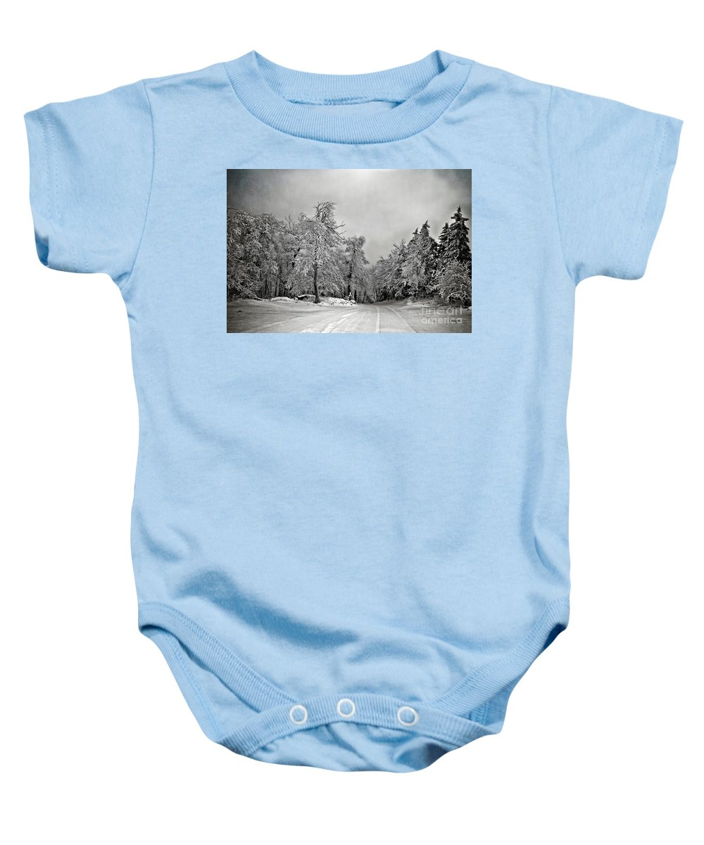 Snow Baby Onesie featuring the photograph Break In The Storm by Lois Bryan