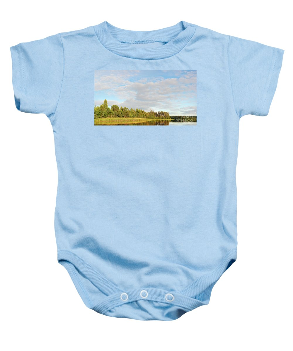 Area Baby Onesie featuring the photograph Coast Of Summer Lake Shined With Sun Beams by Vadzim Kandratsenkau